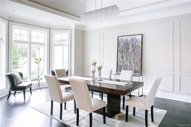 - Dining Room with large bay window and beautiful wall and ceiling moldings