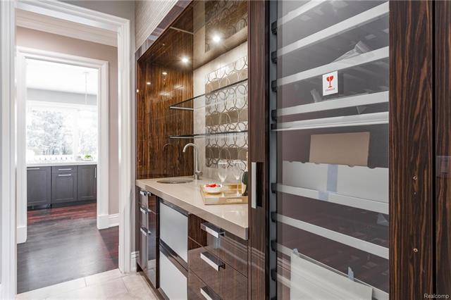 - Butler's Pantry with lacquered cabinetry, recessed lighting, glass shelving, hand painted waill tili