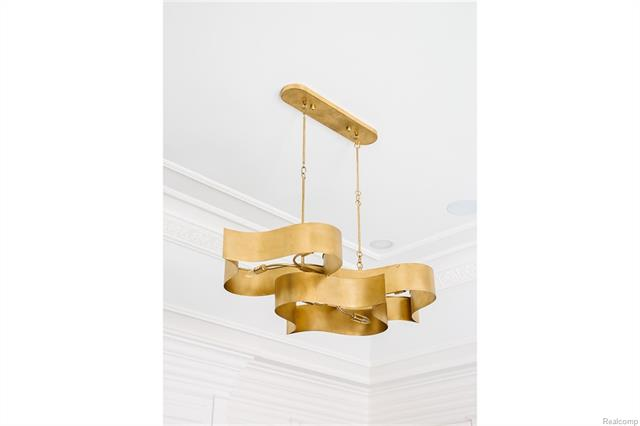 - Close up of contemporary brushed gold tone fixture in Library