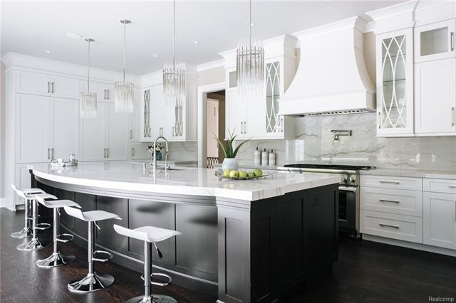 - Kitchen by Millennium with custom double bow glass cabinets, thoughtful pullouts and pocket doors an