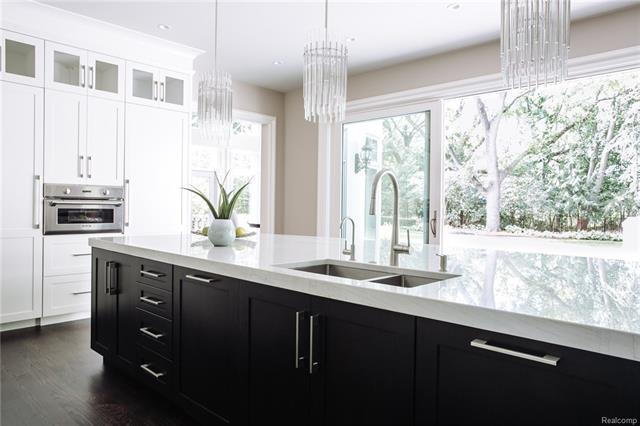 - Alternate view of Kitchen with double refrigerators boasting custom doors flanking the steam oven