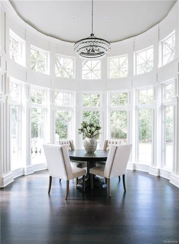 - Sunny Breakfast Room with view of seating area in arched wall of windows