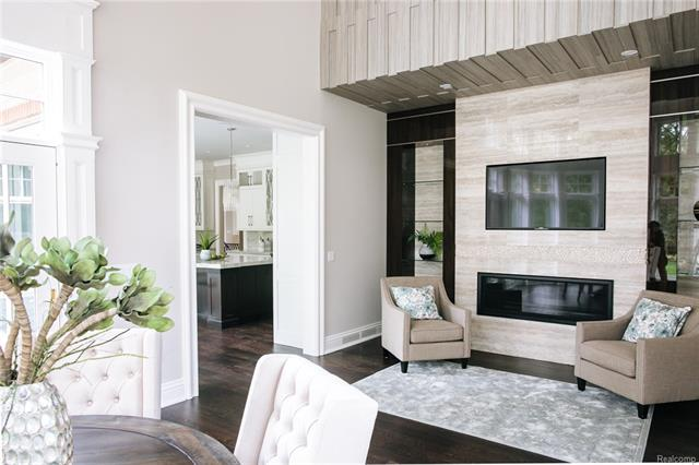 - Breakfast Room off Kitchen with porcelain surround linear fireplace, imported lacquered cabinetry an