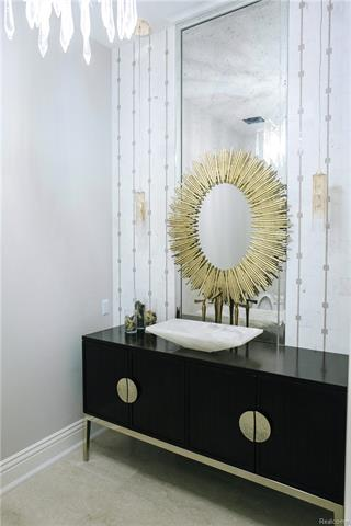 - Powder Room with Carerra micro-marble wall with gold detail