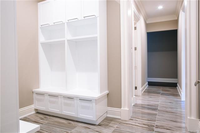- Locker style storage by Millenium with porcelain flooring in Mud Room area