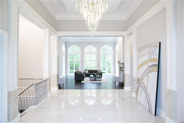 - Grand Foyer with dramatic imported chandelier with view into Living Room