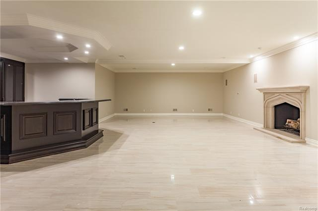 - Theater Room area to right of bar and view of gas fireplace with limestone surround