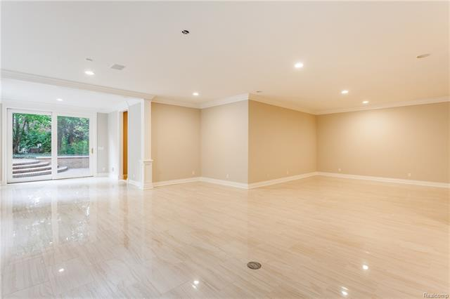 - Great Room on lower level with porcelain flooring. Sliding door with exit to pool and view of entry