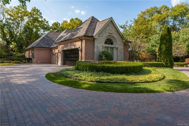 -  View from driveway, approaching the home showing masterful landscaping. Circular turnaround is beyo