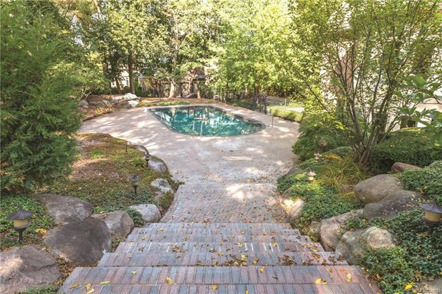 - Exit from lower level to pool on brick paver steps with side boulders and lighting