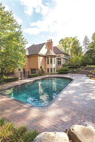 - View of pool and herringbone paver patio