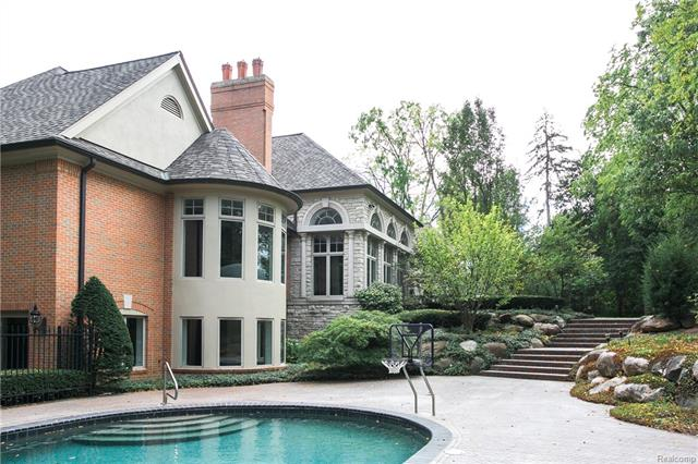 - In-ground pool with herringbone brick pavers