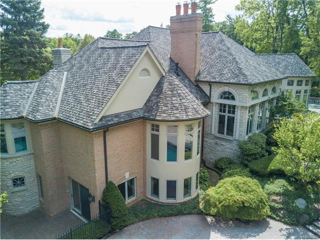 - Aerial view of the one story home showing walkouts on both the main and lower levels