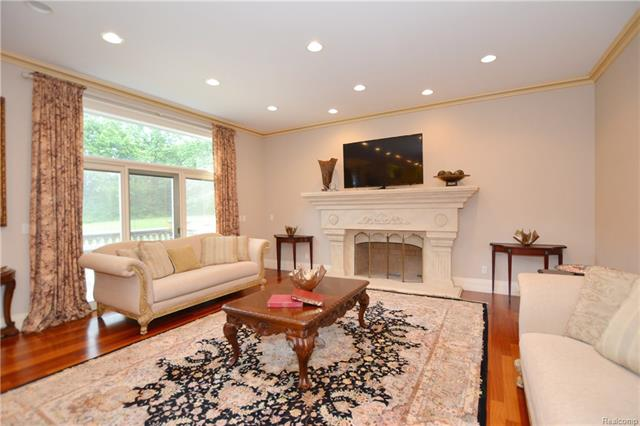 - 13aa    Living Room With Limestone Fireplace    Orchard Ridge 5249 august_14.JPG