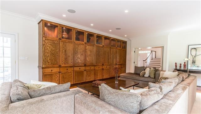 - Family room wall of built-ins with hidden wet bar