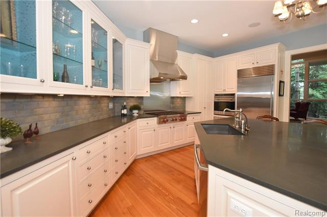 - Custom cabinetry & blue stone counters/island