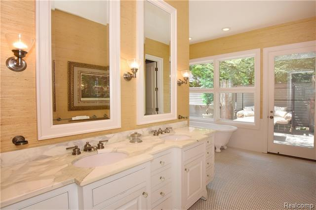 - Marble master bath with dual sink and heated flrs