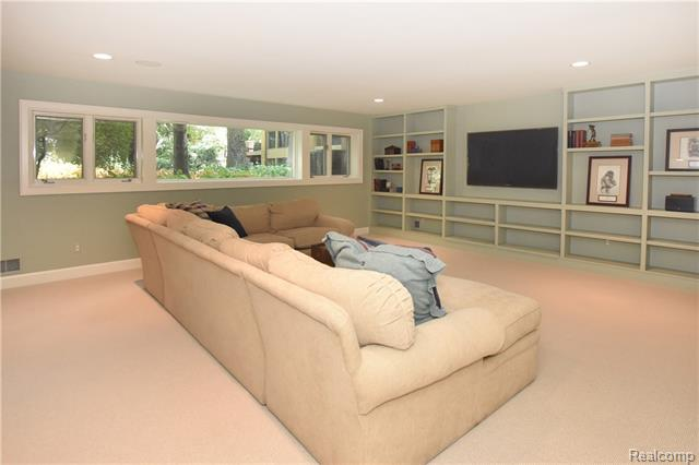 - Lower level rec room with wall of built-ins