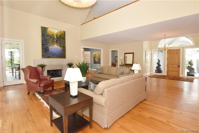 - Living room view to foyer, kitchen & dining room & upper loft